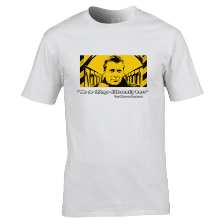 """Bespoke Tony Wilson T-Shirt designed by artist Mark Reynolds. The T-Shirts features a portrait of Tony Wilson and the quote """"We do things differently here"""". This T-Shirt is available in a wide range of colours and sizes."""
